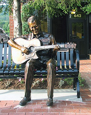 "Old Crow Medicine Show - Sculpture of Doc Watson at the corner King and Depot Streets in Boone, North Carolina; he would invite Old Crow to perform at MerleFest after hearing them at his ""old corner""."