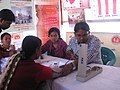Doctors examining patients in a free medical camp during the Bharat Nirman Public Information Campaign organized by Press Information Bureau, at Killa, Gomati district, Tripura on January 26, 2014.jpg