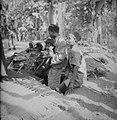 Een Indonesische man met peuter en jonge jongen komen uit een schuilplaats, Bestanddeelnr 11507.jpg