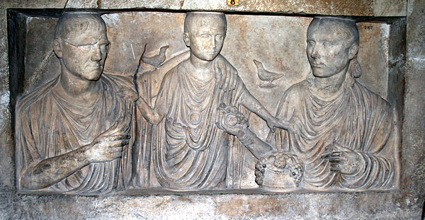 The Roman family, or domus, was one of the ways that the mos maiorum was passed along through the generations Ehepaar mit Kind.JPG