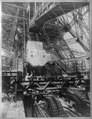 Eiffel Tower machinery with man beside wheel that raises elevator(?), during Paris Exposition LCCN90714899.tif
