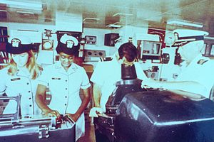 Evelyn J. Fields - Ensigns Karen O'Donnell and Evelyn Fields, unidentified ensign at radar, and Commander Ronald Buffington on the bridge of the NOAA Ship MT MITCHELL. Atlantic Ocean, East Coast of USA (1974).