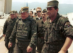 Ratko Mladić - General Mladić (centre) arrives for UN-mediated talks at Sarajevo airport, June 1993.