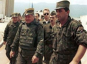 General Ratko Mladic (centre) arrives for UN-m...