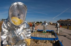 Hazmat suit - US Air Force firefighters in suits with an outer aluminized shell go through a decontamination line during an emergency management exercise.