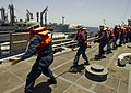 Flickr - Official U.S. Navy Imagery - Sailors aboard USS Taylor haul a fuel probe line during a replenishment at sea..jpg
