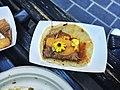 Foie gras and braised short rib taco with arbol chile, flowering herbs.jpg