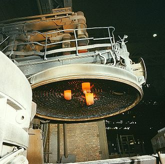 Electric arc furnace - The roof of an arc furnace removed, showing the three electrodes