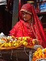 Girl Vendor of Flowers - Along Ghats - Varanasi - Uttar Pradesh - India (12499039093).jpg