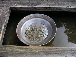 Gold prospecting - A gold pan.