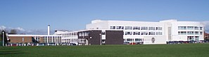 Gosforth Academy - Gosforth High's buildings as they appeared in 2007. The white 2002 building is on the right side, and an additional structure has since been built to the rear-left.