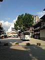 Grand ginkgo tree of Kushida Shrine from front of decorated dashi.jpg