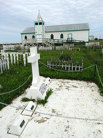 Fort McPherson, Northwest Territories - Image: Grave of NWMP Lost Patrol with Anglican Church at Rear Fort Mc Pherson Northwest Territories Canada