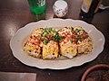 Grilled yellow sweet corn, pork cracklins, queso fresco, aleppo, smokey miso aioli - 45994811624.jpg