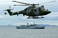 HMS Ocean conducting a VERTREP with RFA Fort Austin. MOD 45145962.jpg