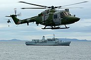 HMS Ocean conducting a VERTREP with RFA Fort Austin. MOD 45145962