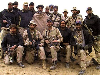 Fall of Kandahar - Operational Detachment Alpha 574 of the U.S. Army Special Forces alongside Hamid Karzai at Kandahar Province in October 2001.