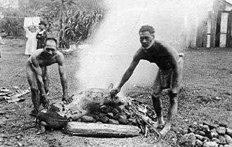 Luau - Hawaiians roast a pig for an 1890 lūʻau