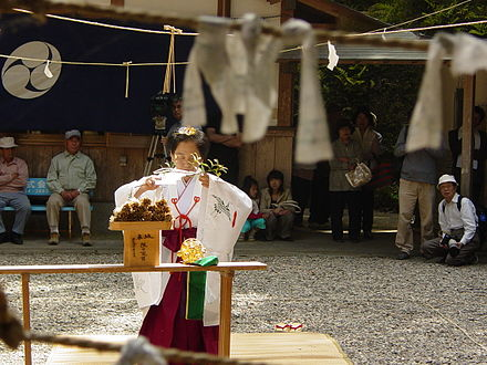 A miko (woman consecrated to a Shinto deity) at Inari Shrine. Head miko in Inari shrine, Tanabe 179738668 4dc16b0c21 o.jpg