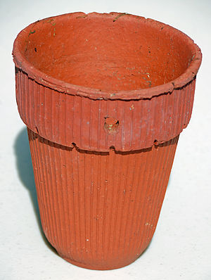 Naval stores industry - Herty turpentine cup, made of clay.  The hole is for nailing to a pine tree.