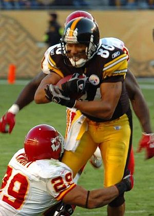 Hines Ward - Ward attempts to break Sammy Knight's tackle during a game against the Kansas City Chiefs in 2006.