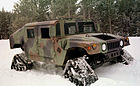 Humvee equipped with four snow treads