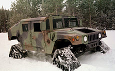 Humvee equipped with four snow treads.jpg