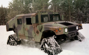 Mattracks Inc. - At the Bridgeport, California Mountain Warfare Training Center in March 1997, a test HMMWV drives through the snow, equipped with Mattracks treads.
