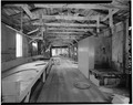 INTERIOR, LENGTH OF PIER, LOOKING SOUTHWEST - F. E. Booth Company Pier, Bolinas, Marin County, CA HABS CAL,21-BOLI,1-12.tif