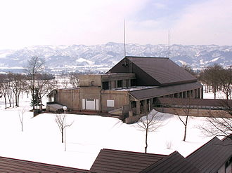 International University of Japan - IUJ campus in winter, with the Echigo-Sanzan mountains in the background