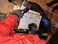 Iditarod checker writes finishing time (4446539814).jpg