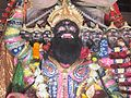 Idol showing Ravana lifting Kailasha at Gosani Jatra, Puri.jpg