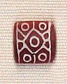 Indus carnelian beads with white design imported to Susa in 2600-1700 BCE LOUVRE Sb 13099 (detail).jpg