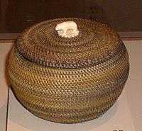 Inuit basket made by Kinguktuk (1871-1941) of Barrow, Alaska. Ivory handle. Displayed at Museum of Man, San Diego, California.