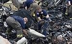 Investigators combing through wreckage from UPS flight 1354 (9518977092).jpg