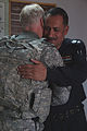 Iraqi Army Col. Raheem, right, from Tal Kayf Police Station, hugs U.S. Army Chief Warrant Officer 5 Paul Holton from 141st Military Intelligence Battalion, at Tal Kayf in Mosul, Iraq, May 3, 2011 110503-A-RH393-100.jpg