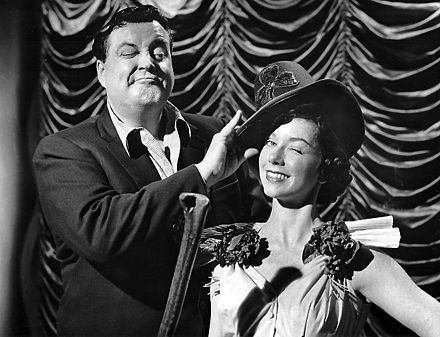 Gleason and June Taylor dancer Margaret Jeanne get ready for St. Patrick's Day 1955