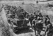 Japanese tankettes with pioneer troops marching towards Wu-han, near Na-hsi