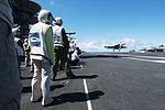 Japanese visitors observe a U.S. Navy F-A-18E Super Hornet aircraft assigned to Strike Fighter Squadron (VFA) 115 make an arrested landing on the flight deck of the aircraft carrier USS George Washington (CVN 130820-N-XK455-110.jpg