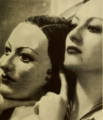 Joan Crawford holding mask of herself.png