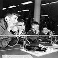 Jongens in platenwinkel - Boys in a record shop (6808271845).jpg