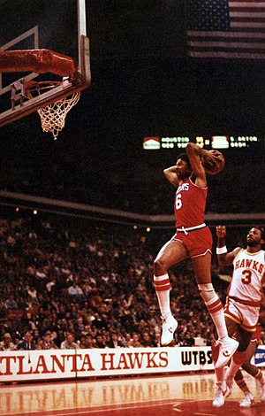 "Slam dunk - Julius Erving performing a ""backscratcher"" tomahawk dunk in 1981"