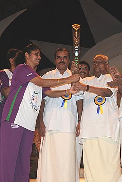 K.M Beenamol hands over the Queen's Baton to the Chief Minister of Kerala - 2010 (cropped).jpg