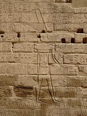 Shoshenq I - The Triumphal Relief of Shoshenq I near the Bubastite Portal at Karnak, depicting the god Amun-Re receiving a list of cities and villages conquered by the king in his Near Eastern military campaigns.