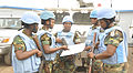 Kinshasa, DR Congo- Female soldiers of the Ghanaian battalion accessing map before patrol in Kinshasa. (23274367254).jpg