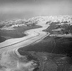 Knik Glacier, terminus in foreground, valley glacier with medial moraines, August 25, 1964 (GLACIERS 5007).jpg