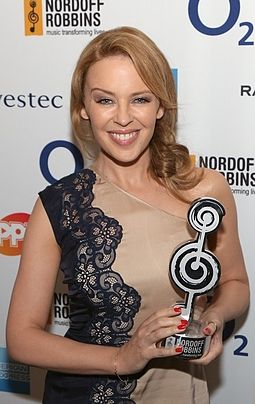 Kylie Minogue, a popular and successful dance-pop musician from the late-1980s until the early-2010s Kylie Minogue Cropped Sliver Spoon Awards 2012.jpg