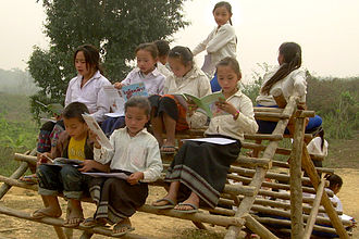 Big Brother Mouse - Lao students reading their first books at a school book party
