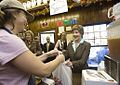 Laura Bush makes a purchase at Franklin Cider Mill in Franklin, Mich., 2006.jpg