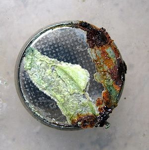 Button cell - Leaked and corroded button cell
